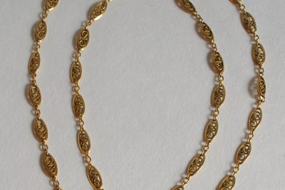 Un sautoir en or maillons ajourés. Poids brut : 18,1 g
